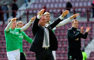 Celtic manager Brendan Rodgers and his players celebrate winning the league with the fans after the Ladbrokes Scottish Premiership match at Tynecastle Stadium, Edinburgh. PRESS ASSOCIATION Photo. Picture date: Sunday April 2, 2017. See PA story SOCCER Hearts. Photo credit should read: Andrew Milligan/PA Wire. EDITORIAL USE ONLY