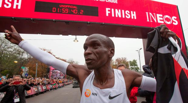 Kenya's Eliud Kipchoge celebrates after busting the two-hour marathon barrier.