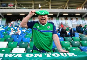 BELFAST, NORTHERN IRELAND - MAY 27: A Northern Ireland fan poses with a green beret before the international friendly game between Northern Ireland and Belarus on May 26, 2016 in Belfast, Northern Ireland. (Photo by Charles McQuillan/Getty Images)