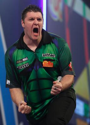 Marching on: Daryl Gurney during his emphatic victory