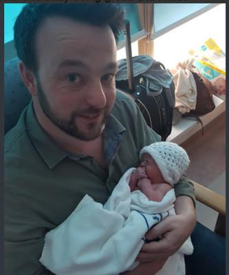 SDLP leader Colum Eastwood MLA with his new baby daughter. [Photo: Twitter]