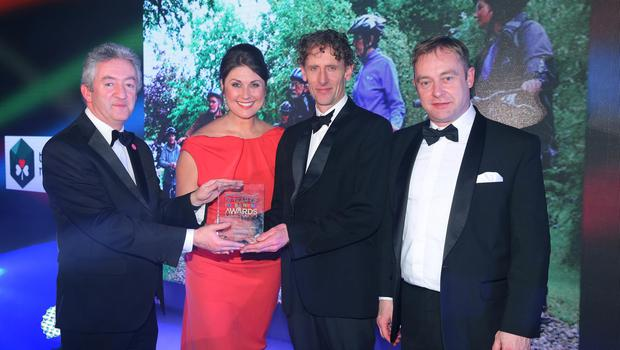 Press Eye - Belfast - Northern Ireland - 2nd February 2017 -    NI Year of Food & Drink Awards at the Culloden Hotel.  Award 5 Best NI Tours & Trails Sarah Travers, host of the NI Year of Food & Drink Awards is pictured with John McGrillen, CEO of Tourism NI, presenting Far & Wild the award for Best NI Tours & Trails for Cycle Sperrins. The inaugural awards celebrated the collaborative efforts of all from the food, drink and hospitality industry during the NI Year of Food & Drink 2016, with an gala awards evening at the Culloden Hotel.  Pictured left to right: John McGrillen, CEO of Tourism NI, Sarah Travers, Lawrence McBride and  Kevin Hickey.  Photo by Kelvin Boyes / Press Eye.