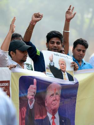 "Right-wing activists of India's Hindu Sena celebrate the potential victorious outcome for US Republican presidential candidate Donald Trump in the US presidential elections, in New Delhi on November 9, 2016.   Euphoric Donald Trump supporters transformed into a sea of ""Make America Great Again"" hats, shouting ""USA"" and partying late into the night as the billionaire appeared within reach of victory. / AFP PHOTO / PRAKASH SINGHPRAKASH SINGH/AFP/Getty Images"