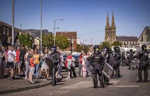 Riot Police and contractors remove wood for a bonfire in the Distillery Street area of west Belfast on August 8th 2020 (Photo by Kevin Scott for Belfast Telegraph)