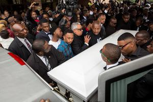 BALTIMORE, MD - APRIL 27:  Pallbearers carry the casket of Freddie Gray to the hearse after his funeral service at New Shiloh Baptist April 27, 2015 in Baltimore, Maryland. Gray, 25, was arrested for possessing a switch blade knife April 12 outside the Gilmor Homes housing project on Baltimore's west side. According to his attorney, Gray died a week later in the hospital from a severe spinal cord injury he received while in police custody.  (Drew Angerer/Getty Images)