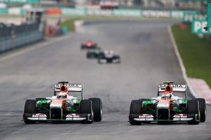 KUALA LUMPUR, MALAYSIA - MARCH 24:  Paul di Resta (L) of Great Britain and Force India and team mate Adrian Sutil (R) of Germany and Force India drive during the Malaysian Formula One Grand Prix at the Sepang Circuit on March 24, 2013 in Kuala Lumpur, Malaysia.  (Photo by Mark Thompson/Getty Images)