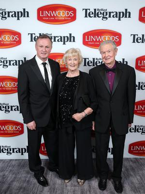 That's our boy: Michael O'Neill with his parents Pat and Des