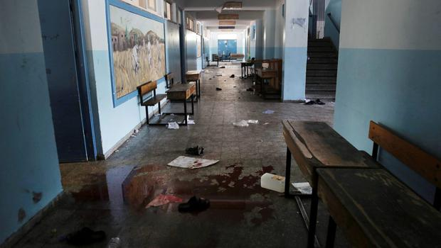 Blood and and discarded belongings are left behind at a U.N. school in Beit Hanoun, in the northern Gaza Strip, Thursday, July 24, 2014. (AP Photo/Adel Hana)