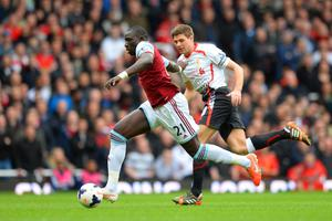 LONDON, ENGLAND - APRIL 06:  Mohamed Diame of West Ham is pursued by Steven Gerrard of Liverpool during the Barclays Premier League match between West Ham United and Liverpool at Boleyn Ground on April 6, 2014 in London, England.  (Photo by Mike Hewitt/Getty Images)