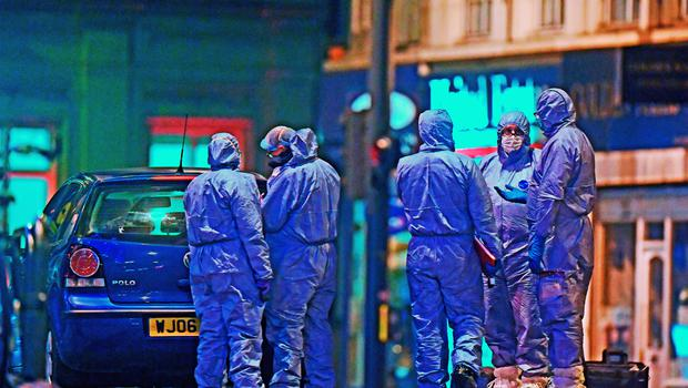 Police forensic officers work at the scene in Streatham High Road (Victoria Jones/PA)