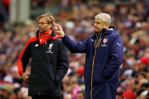 LIVERPOOL, ENGLAND - JANUARY 13:  Jurgen Klopp, manager of Liverpool and Arsene Wenger Manager of Arsenal look on during the Barclays Premier League match between Liverpool and Arsenal at Anfield on January 13, 2016 in Liverpool, England.  (Photo by Alex Livesey/Getty Images)
