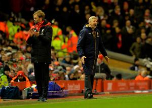 Liverpool's German manager Jurgen Klopp (L) and Arsenal's French manager Arsene Wenger react during the English Premier League football match between Liverpool and Arsenal at Anfield stadium in Liverpool, north-west England on January 13, 2016. AFP PHOTO / PAUL ELLIS RESTRICTED TO EDITORIAL USE. NO USE WITH UNAUTHORIZED AUDIO, VIDEO, DATA, FIXTURE LISTS, CLUB/LEAGUE LOGOS OR 'LIVE' SERVICES. ONLINE IN-MATCH USE LIMITED TO 75 IMAGES, NO VIDEO EMULATION. NO USE IN BETTING, GAMES OR SINGLE CLUB/LEAGUE/PLAYER PUBLICATIONS.PAUL ELLIS/AFP/Getty Images