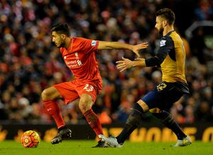 Liverpool's German midfielder Emre Can (L) holds off Arsenal's French striker Olivier Giroud during the English Premier League football match between Liverpool and Arsenal at Anfield stadium in Liverpool, north-west England on January 13, 2016. AFP PHOTO / PAUL ELLIS RESTRICTED TO EDITORIAL USE. NO USE WITH UNAUTHORIZED AUDIO, VIDEO, DATA, FIXTURE LISTS, CLUB/LEAGUE LOGOS OR 'LIVE' SERVICES. ONLINE IN-MATCH USE LIMITED TO 75 IMAGES, NO VIDEO EMULATION. NO USE IN BETTING, GAMES OR SINGLE CLUB/LEAGUE/PLAYER PUBLICATIONS.PAUL ELLIS/AFP/Getty Images
