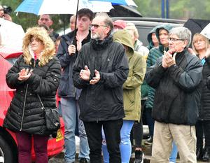 There was a round of spontaneous applause after missing priest Father Stephen Rooney's brother Philip had thanked the crowd gathered in the pouring rain at Short Strand in east Belfast for a prayer vigil for the 66 year-old local man who is feared dead in a boating accident near Detroit in the United States.