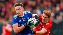 Tough battle: Fintan Kelly (left) and Tyrone's Peter Harte lock horns