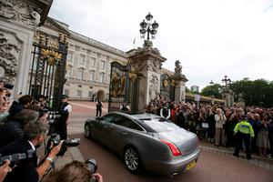 A car carrying outgoing British prime minister David Cameron enters the gates at Buckingham Palace in central London on July 13, 2016 for Cameron to have an audience with Queen Elizabeth II to tender his resignation as prime minister.  Outgoing British prime minister David Cameron urged his successor Theresa May on Wednesday to maintain close ties with the EU even while negotiating to leave it, as he paid a fond farewell to MPs hours before leaving office. Cameron will tender his resignation on July 13 to Queen Elizabeth II at Buckingham Palace, after which the monarch will task the new leader of the Conservative Party Theresa May with forming a government.  / AFP PHOTO / DANIEL LEAL-OLIVASDANIEL LEAL-OLIVAS/AFP/Getty Images