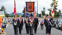 Press Eye - Belfast - Northern Ireland - 12th July 2019 -   General view of the Twelfth of July parade in Holywood, County Down.  Twelfth of July parades are taking place in 18 locations across Northern Ireland.  Tens of thousands of people are expected at the marches, which mark the anniversary of the Battle of the Boyne.  William III - the Dutch-born Protestant better known as William of Orange or King Billy - defeated the Catholic King James II in County Meath in July 1690.  Photo by Kelvin Boyes / Press Eye.