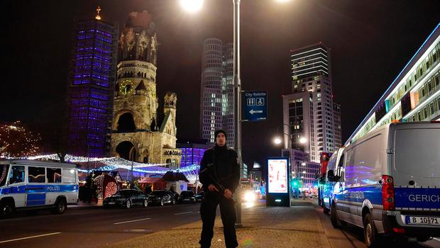 A police man stands at the site where a truck speeded into a christmas market in Berlin, on December 19, 2016 killing nine persons and injuring at least 50 people. / AFP PHOTO / John MACDOUGALLJOHN MACDOUGALL/AFP/Getty Images