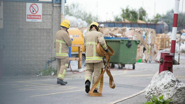 Firefighters deal with a fire at recycling centre on the Limestone Road in North Belfast.