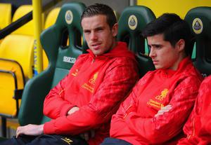 NORWICH, ENGLAND - APRIL 20: Jordan Henderson of Liverpool looks on from the bench during the Barclays Premier League match between Norwich City and Liverpool at Carrow Road on April 20, 2014 in Norwich, England.  (Photo by Michael Regan/Getty Images)