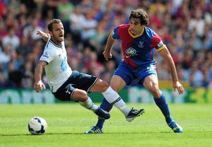 LONDON, ENGLAND - AUGUST 18:  Roberto Soldado of Tottenham Hotspur is tackled by Mile Jedinak of Crystal Palace during the Barclays Premier League match between Crystal Palace and Tottenham Hotspur at Selhurst Park on Augsut 18, 2013 in London, England.  (Photo by Jamie McDonald/Getty Images)
