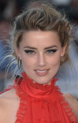 Amber Heard claims Johnny Depp was violent towards her during their marriage (Anthony Devlin/PA)