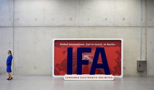 """(FILES) This picture taken on September 3, 2014 shows a fair hostess next to a board with the IFA logo during the first press day of the consumer electronics trade fair """"Internationale Funk Ausstellung """"(IFA) in Berlin. IFA, one of Europe's biggest showcases of the latest electronic gadgets, is scheduled to open on September 4 and run until September 9, 2015.    AFP PHOTO / TOBIAS SCHWARZTOBIAS SCHWARZ/AFP/Getty Images"""
