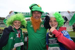 Northern Ireland fans George King with twin son's Mason and Christain before the match against Hungary during Monday night's UEFA EURO 2016 Group  F Qualifier at the National Football Stadium, Windsor Park, Belfast. Picture by Brian Little/Presseye