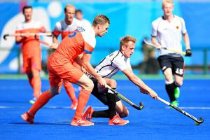 Netherlands' Mirco Pruijser (L) and Germany's Niklas Wellen vie during the mens's field hockey Germany vs Netherlands match of the Rio 2016 Olympics Games at the Olympic Hockey Centre in Rio de Janeiro on August, 12 2016. / AFP PHOTO / MANAN VATSYAYANAMANAN VATSYAYANA/AFP/Getty Images