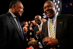 LAS VEGAS, NV - OCTOBER 19:  Former presidential candidate, Dr. Ben Carson speaks with Jesse Jackason before the start of the third U.S. presidential debate at the Thomas & Mack Center on October 19, 2016 in Las Vegas, Nevada. Tonight is the final debate ahead of Election Day on November 8.  (Photo by Chip Somodevilla/Getty Images)