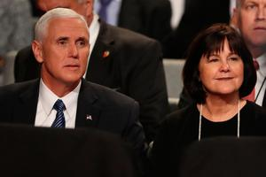 """Republican candidate for Vice President Mike Pence and his wife Karen are seen before the final presidential debate at the Thomas & Mack Center on the campus of the University of Las Vegas in Las Vegas, Nevada on October 19, 2016. Democrat Hillary Clinton and rival Donald Trump face off in their last presidential debate on October 19, with the Republican candidate spiraling downward amid allegations of sexual misconduct and wild charges of a """"rigged"""" US election. / AFP PHOTO / POOL / joe raedleJOE RAEDLE/AFP/Getty Images"""