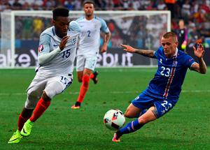 Iceland's defender Ari Skulason (R) and England's forward Daniel Sturridge vie for the ball during Euro 2016 round of 16 football match between England and Iceland at the Allianz Riviera stadium in Nice on June 27, 2016. / AFP PHOTO / ANNE-CHRISTINE POUJOULATANNE-CHRISTINE POUJOULAT/AFP/Getty Images