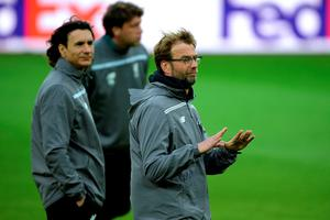 Liverpool's assistant coach Zeljko Buvac (left) will take time away from the first-team for the remainder of the season, leaving Peter Krawietz (back) to aid head coach Jurgen Klopp.