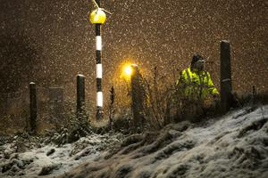 People make their way to work as snow falls over Belfast. Picture Colm O'Reilly