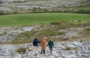 THE BURREN, IRELAND - MAY 19:  Prince Charles, Prince of Wales with Brendan Dunford manager of Burren Life and Bridgid Barry Burrenbeo during his visit to The Burren, an ancient and dramatic stony outcrop famed for its rare plant life, biodiversity and archaeology, on the first day of his Royal visit to the Republic of Ireland on May 19, 2015 in County Clare, Ireland. The Prince of Wales and Duchess of Cornwall arrived in Ireland today for their four day visit to the Republic and Northern Ireland, the visit has been described by the British Embassy as another important step in promoting peace and reconciliation. (Photo by Eddie Mulholland - WPA Pool/Getty Images)