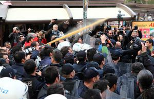 Police use tear-inducing agent against demonstrators during a protest against the arrest of journalists Can Dundar and Erdem Gul in Ankara on November 27, 2015. An Istanbul court on November 26 charged Cumhuriyet's editor-in-chief Can Dundar and Erdem Gul, the paper's Ankara bureau chief, with spying after they alleged Turkey's intelligence had covertly sent arms to Islamist rebels in Syria.  AFP PHOTO / ADEM ALTANADEM ALTAN/AFP/Getty Images