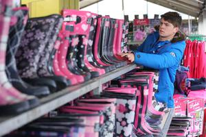Press Eye - Belfast - Northern Ireland - 15th May 2012 - First day of the 2013 Balmoral Show in partnership with Ulster Bank at the new site, Balmoral Park. Greg Fruchtenicht from Ruffle Clothing prepares his stall. Picture by Kelvin Boyes / Press Eye