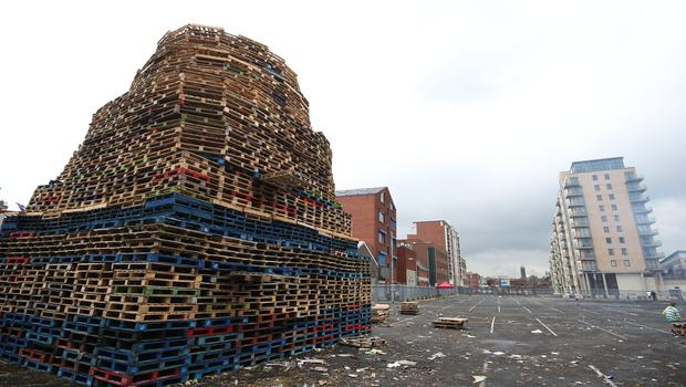 11th night bonfires are prepared around Belfast as July 12th draws near. Sandy Row, South Belfast.