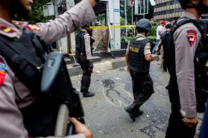 JAKARTA, INDONESIA - JANUARY 14:  Indonesian policemen guard the blast site after a series of explosions hit the Indonesia capital on January 14, 2016 in Jakarta, Indonesia. Reports of explosions and gunshots in the centre of the Indonesian capital, including outside the United Nations building and in the front of the Sarinah shopping mall, an area with many luxury hotels, embassies and offices.  (Photo by Oscar Siagian/Getty Images)