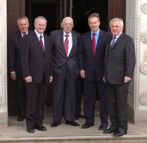 PACEMAKER BELFAST 8/5/2007. Prime Minister Tony Blair poses on the steps as he leaves Stormont Parliment on the first day of the Northern Ireland Assembly with Bertie Ahern watched by First Minister and Deputy First Minister Ian Paisley and Martin McGuinness. Picture Charles McQuillan/Pacemaker