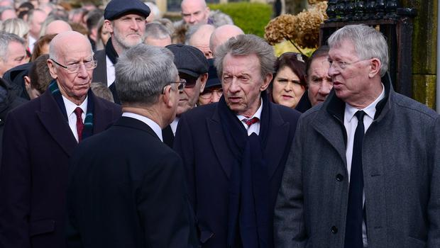 Among the mourners to arrive at the church were former Manchester United manager Sir Alex Ferguson, Sir Bobby Charlton and former striker Denis Law. Picture By: Arthur Allison. Pacemaker Press.