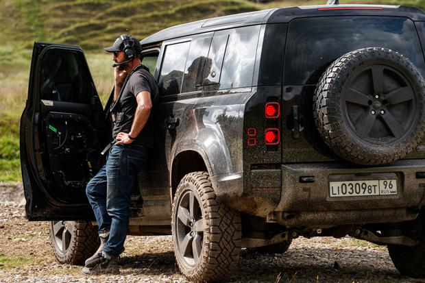 Behind the scenes of Stunt Coordinator Lee Morrison with the New Land Rover Defender featured in No Time To Die