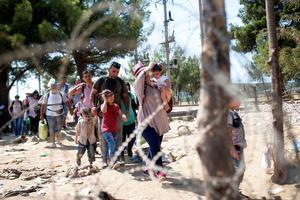 Migrants cross the Greek-Macedonian border near the town of Gevgelija on September 4, 2015. More than 230,000 refugees and migrants have arrived in Greece by sea this year, a huge rise from 17,500 in the same period in 2014, deputy shipping minister Nikos Zois said. AFP PHOTO / ROBERT ATANASOVSKIROBERT ATANASOVSKI/AFP/Getty Images
