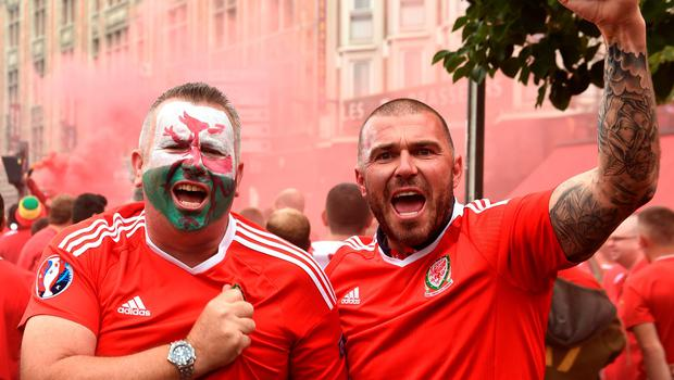 Wales fans soak up the atmosphere in Lille prior to the UEFA Euro 2016, quarter final match at the Stade Pierre Mauroy, Lille. PRESS ASSOCIATION Photo. Picture date: Friday July 1 2016. See PA story SOCCER Wales. Photo credit should read: Joe Giddens/PA Wire. RESTRICTIONS: Use subject to restrictions. Editorial use only. Book and magazine sales permitted providing not solely devoted to any one team/player/match. No commercial use. Call +44 (0)1158 447447 for further information.