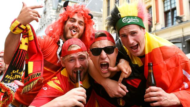 Belgium fans soak up the atmosphere in Lille prior to the UEFA Euro 2016, quarter final match at the Stade Pierre Mauroy, Lille. PRESS ASSOCIATION Photo. Picture date: Friday July 1 2016. See PA story SOCCER Wales. Photo credit should read: Joe Giddens/PA Wire. RESTRICTIONS: Use subject to restrictions. Editorial use only. Book and magazine sales permitted providing not solely devoted to any one team/player/match. No commercial use. Call +44 (0)1158 447447 for further information.