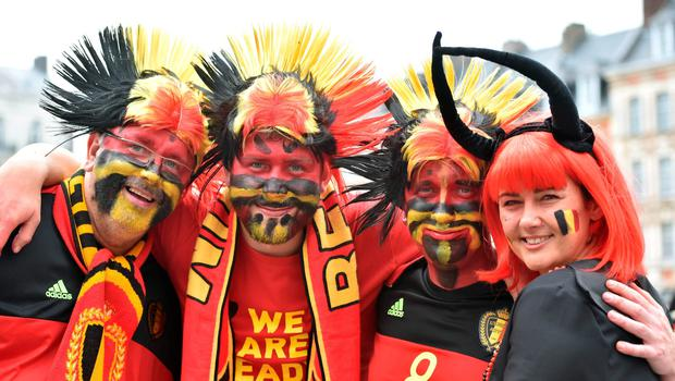 Belgium's supporters pose in the main square, La Grand Place, in Lille on July 1, 2016 ahead of the Euro 2016 football tournament quarter final match between Belgium and Wales. / AFP PHOTO / PHILIPPE HUGUENPHILIPPE HUGUEN/AFP/Getty Images