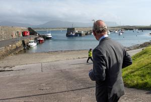 "Britain's Prince Charles, Prince of Wales visits the harbour in the village of Mullaghmore in Ireland on May 20, 2015 where the prince's great-uncle Lord Mountbatten was killed in an IRA explosion in 1979. Britain's Prince Charles spoke of his ""anguish"" at the murder of his godfather by IRA paramilitaries in 1979 as he became the first royal to visit the assassination site in Ireland.  Charles remembered Lord Louis Mountbatten as ""the grandfather I never had"" on an emotional trip to the rugged coastline, saying he understood the suffering of the Irish people in ""a profound way"".  Peter McHugh helped with the rescue effort in the aftermath of the 1979 attack.  AFP PHOTO / POOL / ARTHUR EDWARDSARTHUR EDWARDS/AFP/Getty Images"