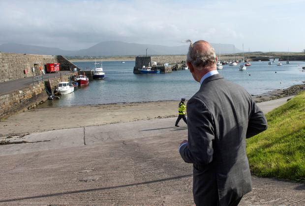 """Britain's Prince Charles, Prince of Wales visits the harbour in the village of Mullaghmore in Ireland on May 20, 2015 where the prince's great-uncle Lord Mountbatten was killed in an IRA explosion in 1979. Britain's Prince Charles spoke of his """"anguish"""" at the murder of his godfather by IRA paramilitaries in 1979 as he became the first royal to visit the assassination site in Ireland.  Charles remembered Lord Louis Mountbatten as """"the grandfather I never had"""" on an emotional trip to the rugged coastline, saying he understood the suffering of the Irish people in """"a profound way"""".  Peter McHugh helped with the rescue effort in the aftermath of the 1979 attack.  AFP PHOTO / POOL / ARTHUR EDWARDSARTHUR EDWARDS/AFP/Getty Images"""