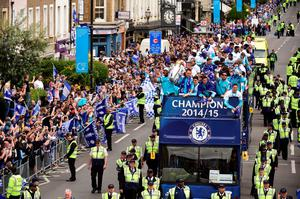 Chelsea's Ivorian striker Didier Drogba (L) and Chelsea's English defender John Terry hold the Premier league trophy as they take part in an open top bus parade along Kings Road in London to celebrate winning the league on May 25, 2015. AFP PHOTO / LEON NEALLEON NEAL/AFP/Getty Images