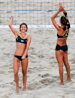RIO DE JANEIRO, BRAZIL - AUGUST 16:  Laura Ludwig (L) and Kira Walkenhorst of Germany celebrate beating Larissa Franca Maestrini and Talita Rocha of Brazil during the beach volleyball Women's Semifinal on Day 11 of the Rio 2016 Olympic Games at the Beach Volleyball Arena on August 16, 2016 in Rio de Janeiro, Brazil.  (Photo by Jamie Squire/Getty Images)
